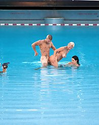 Hot brunette and blond whores fucking a big cock in the pool