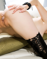 Gorgeous redhead Bree Victoria lays back on her white couch and spreads her long legs to show off her wet pink pussy!