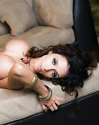 In a devastatingly sexy one-two combo, Ariella Ferrera proudly thrusts out and shows off her spectacular naked boobs and then rolls onto her back and