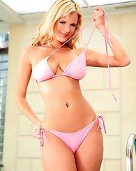 Busty blonde Zuzana Drabinova strips out of her tight bikini to warm herself up.