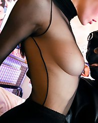 Fetish slut in her stockings dominating a rubber masked guy