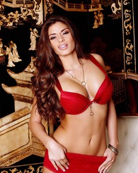 Stunning Madelyn Marie in a red outfit strips for the camera